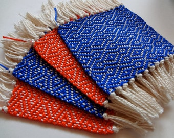 handwoven coaster set in orange and true blue, set of four