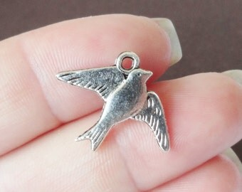 10 Bird Charms (double sided)  22x17x1mm, Hole Approx. 1mm ITEM:AR8