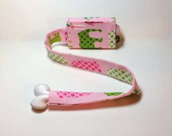 Elephant TuneTube.  Pink and green.  iPhone and iPod headphone earbud cord organizer.