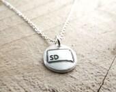 Tiny South Dakota necklace, silver state jewelry map pendant