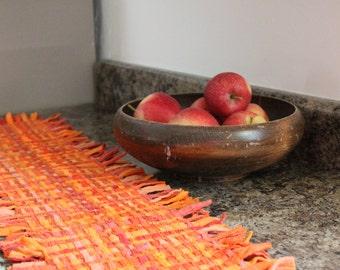 Whimsically Woven Orange Table Runner