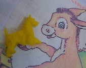itty bitty yellow dog figurine