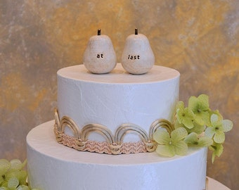 "Wedding cake topper...""at last"" pears ... pears can be made any color you want, tell the world you two are a perfect pair"