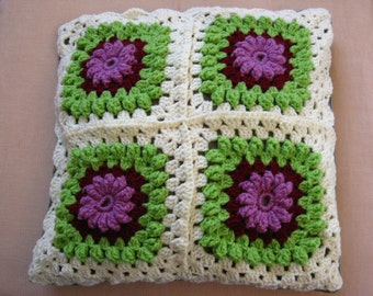 Crochet pillow cover with flowers in three dimensions within 4 granny squares-off white-green and purple