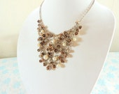 Beautiful vintage brass weaved chain necklace with dangling rose, rhinestones and faux pearls designs