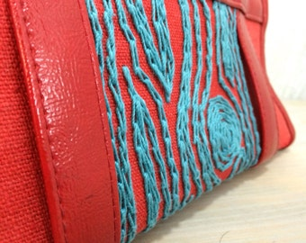 Red handbag with turquoise woodgrain