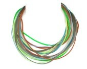 unusual bright color, statement  necklace made from strands of rubber