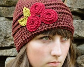 Women's crocheted flower hat -chestnut with a trio of cranberry red roses and pea green leaves