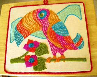 Vintage. Hand embroidered picture of a toucan bird.Colorfull wall hanging