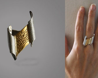 Women silver ring goldplated and textured.