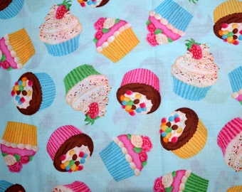 One Yard Tossed Cupcakes on a Blue Background