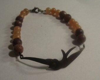 Pretty bronze bird bracelet with pretty gemstones