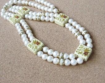 Long vintage faux pearl gold tone & painted floral tile necklace