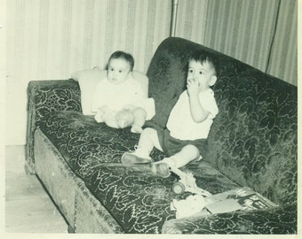 Hanging Out Baby Brothers Sitting on Leaf Print Sofa With Lots of Toys  1940s Vintage Black and White Photo Photograph
