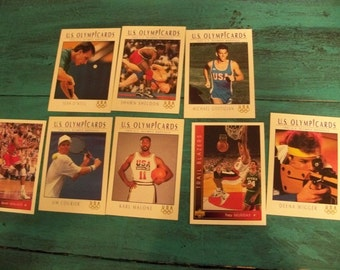 half dozen Olympic trading  cards and 2 sports trading  cards