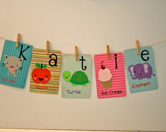 Alphabet cards spelling out Katie.