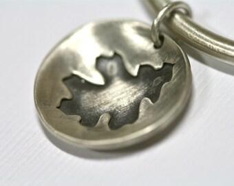 Oak leaf necklace on leather