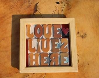 LOVE LIVES HERE, vintage letterpress in a frame.