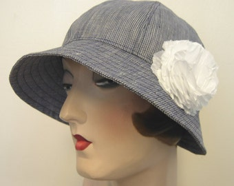 On sale. Ruby Cloche in feather weight blue linen, flower.