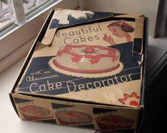 1930's Aluminum Cake Decorator Set