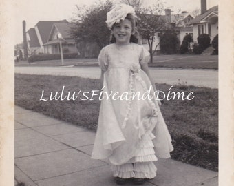 Vintage Photo of an Adorable Little Girl in a Frilly Dress and Hat