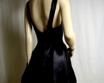 1990's Cocktail Party Dress by Saelee Designer Black Satin Fully Lined with Low Sweetheart Neckline , Revealing Back  French Maid Bust 35
