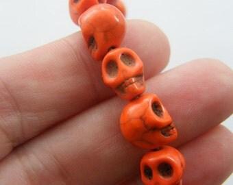 40 Orange skull beads 10 x 8mm