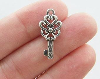 8 Key charms ( double sided ) 23 x 11mm tibetan silver K71