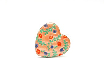 Heart shaped colorful ring with flowers