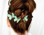 three handmade emerald green silk butterfly hair clips . emerald gypsies . pure dupioni silk