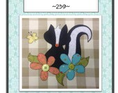 Little Stinker Skunk Applique packaged Pattern for Tea Towel