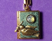 Dove Love Locket- turquoise and gold, holding 14 ways to tell someone you love them, from English to American Sign Language.