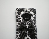 Padded iphone/ipod small camera pouch in black and demask print with contrasting polka dot lining