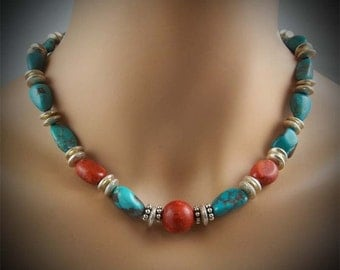 Turqoise, coral and sterling silver beads with handmade sterling clasp.