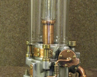 Electric lamp made with recycled metals and glass. Steampunk industrial.