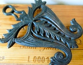Cast Iron Trivet - Virginia Metalcrafters - Mask Shape, Doodler's Dream