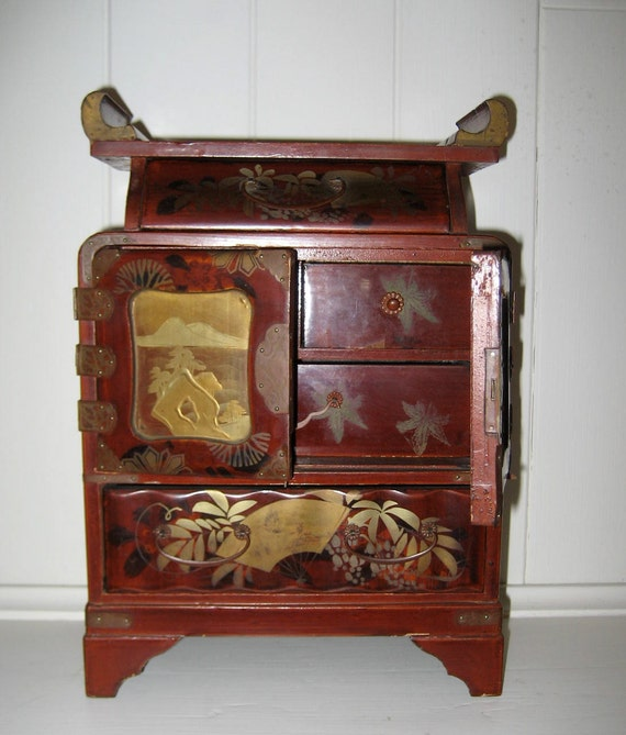 Small vintage asian red lacquered wood chest with drawers and doors