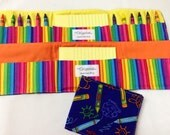 Crayon Print crayon tote in a colorful print complete with 12 crayons and a paper pad