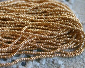11/0 Czech Metallic Dark Gold Seed Beads Preciosa One Hank