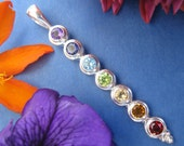 Lovely, Large hanging sterling silver chakra pendant.  Beautiful faceted stones, FREE shipping and gift box.