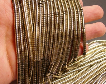 Hematite gold - 4mm heishi beads - full strand -190 beads - AA quality - light gold - 4x2 - PHG67