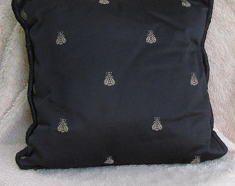 Black and tan or gold pillow with honey bees and cording trim