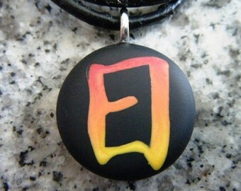 SUN kanji symbol hand carved on a polymer clay black color background. Pendant comes with a FREE necklace