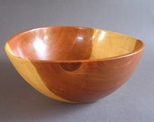 Very large cherry wood salad bowl.