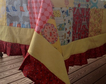 Tablecloth, Handmade, Rectangle, Measures 65X94 Inches. Colors Include Yellow, Red, and Blue. Total of 29 Different Fabrics