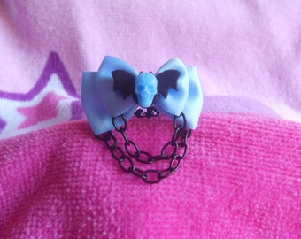 Pastel goth bat and skull ring blue