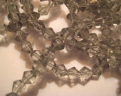 "Gray Glass Beads: Tiny Transparent Faceted Bicones, 4mm, approx. 90 pcs, One 15 1/2"" strand"