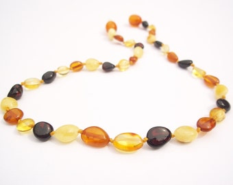 Multicolor Olive shaped  Natural  Baltic Amber teething necklace for your baby .