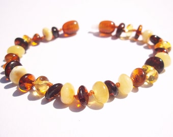 Multicolor  rounded beads Baltic amber baby teething knotted bracelet.