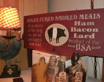 Primitive and distressed smoked meats sign